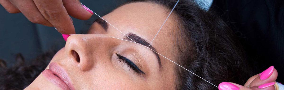 Epilation au fil du visage